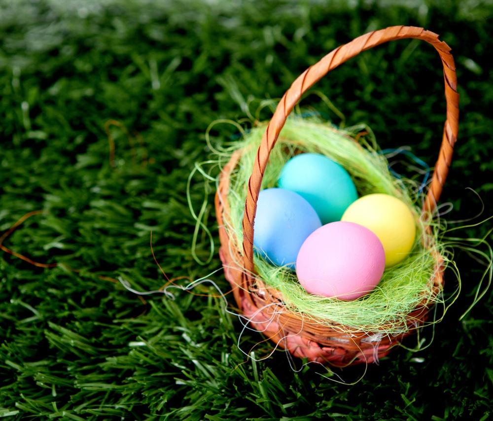 Plain colorful Easter Eggs in a bastket.jpeg