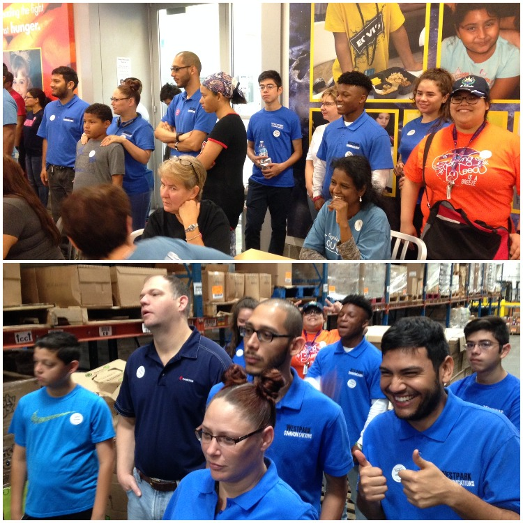 Employees in blue shirts standing - Westpark Communications